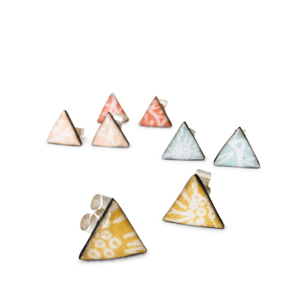 Four pairs of geometric triangle stud earrings handmade from silver, paper and resin by Dittany Rose
