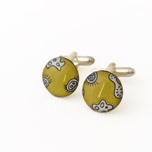 Cuff links with drawings of microorganisms and bacteria made from silver, paper and resin by Dittany Rose