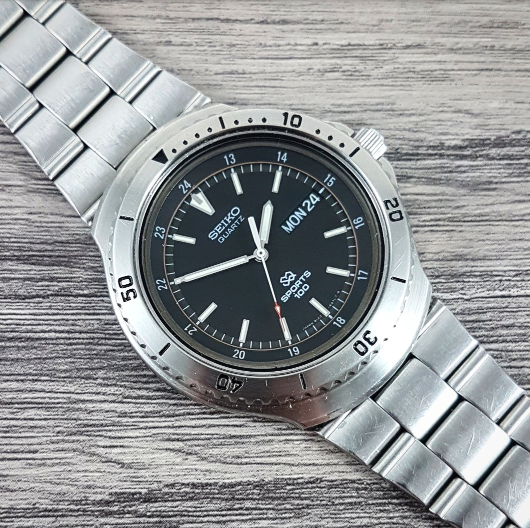 1983 Seiko SQ Sports 100 8123-6040 Quartz