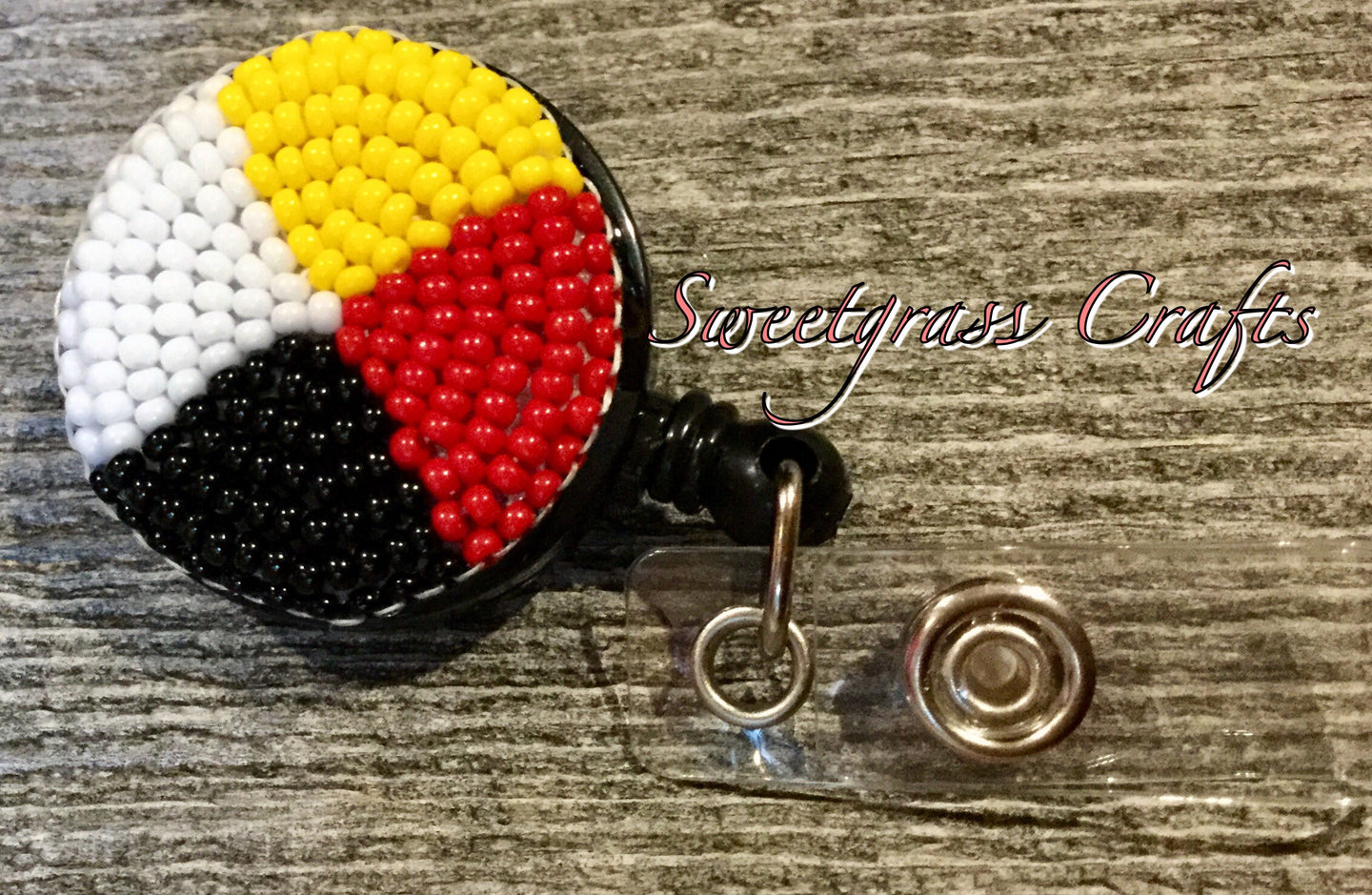 Medicine wheel beaded badge reel