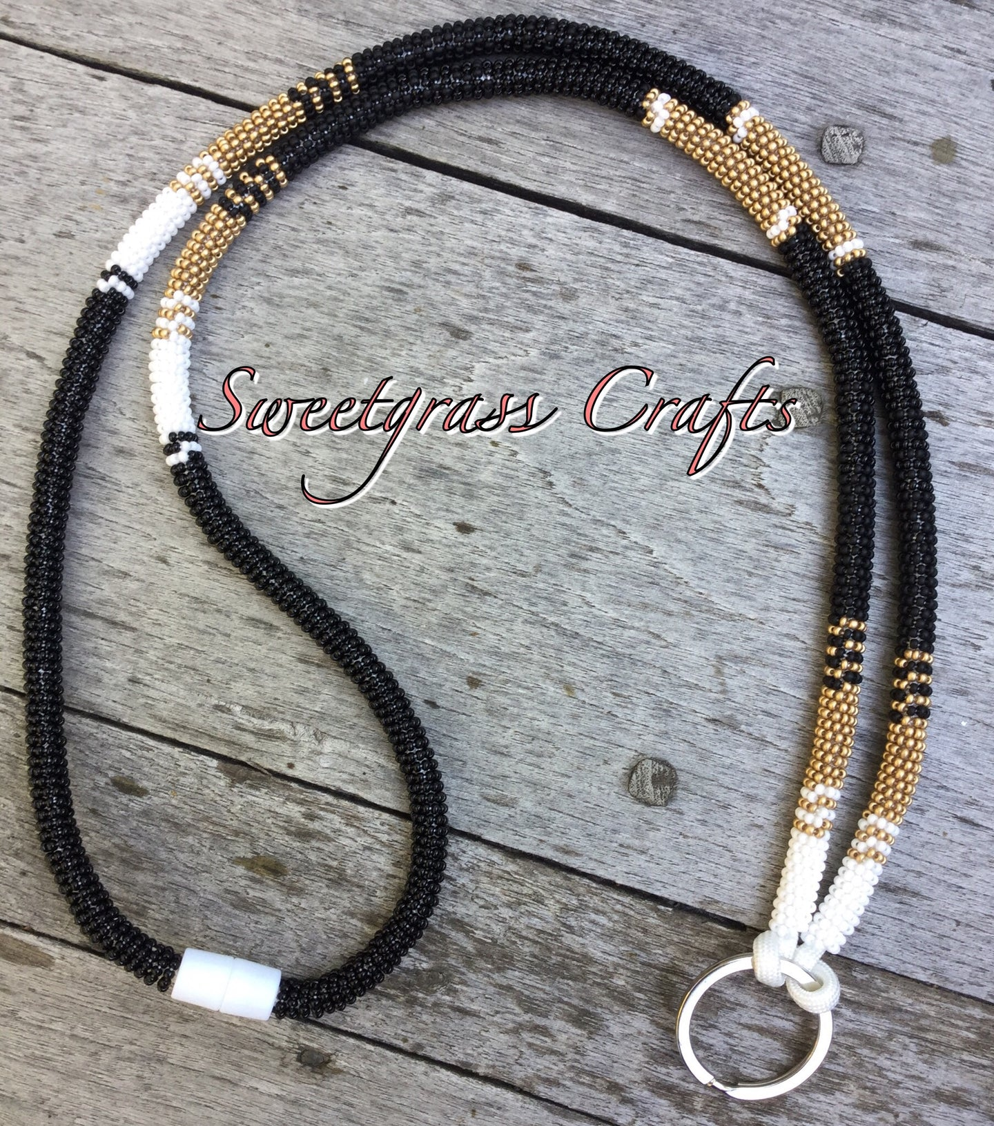 beaded black and gold lanyard