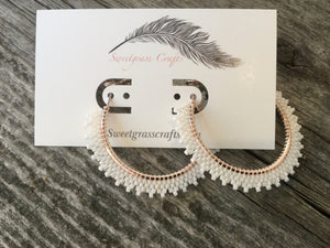 white hoop beaded earrings