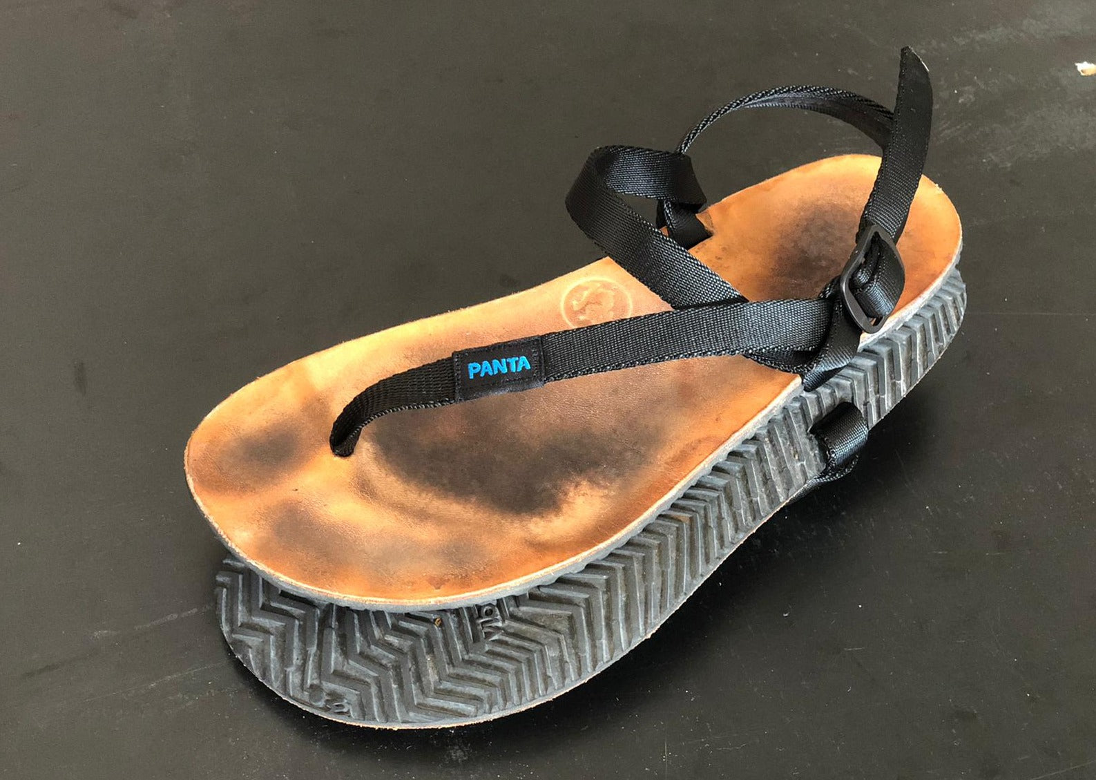 Replacement straps on a used pair of sandals