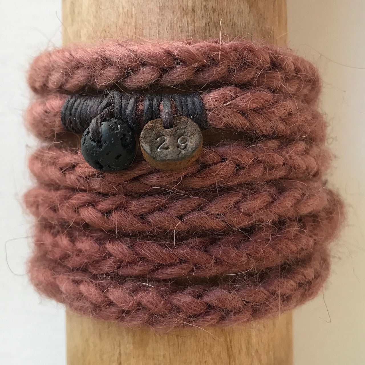 number 29 hand dyed chokecherry woollen wrist wrap