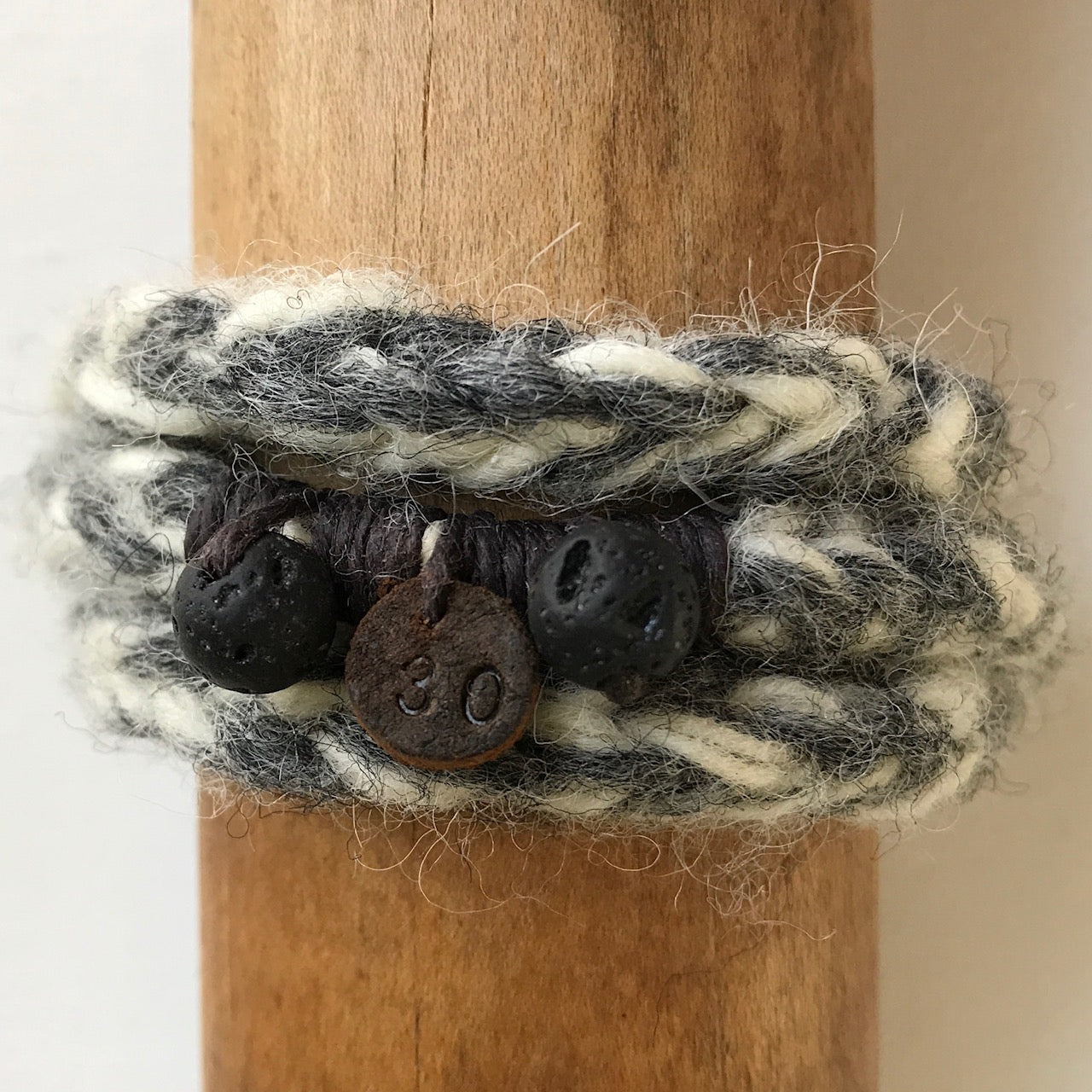 number 30 deep stone and light stone grey woollen wrist wrap