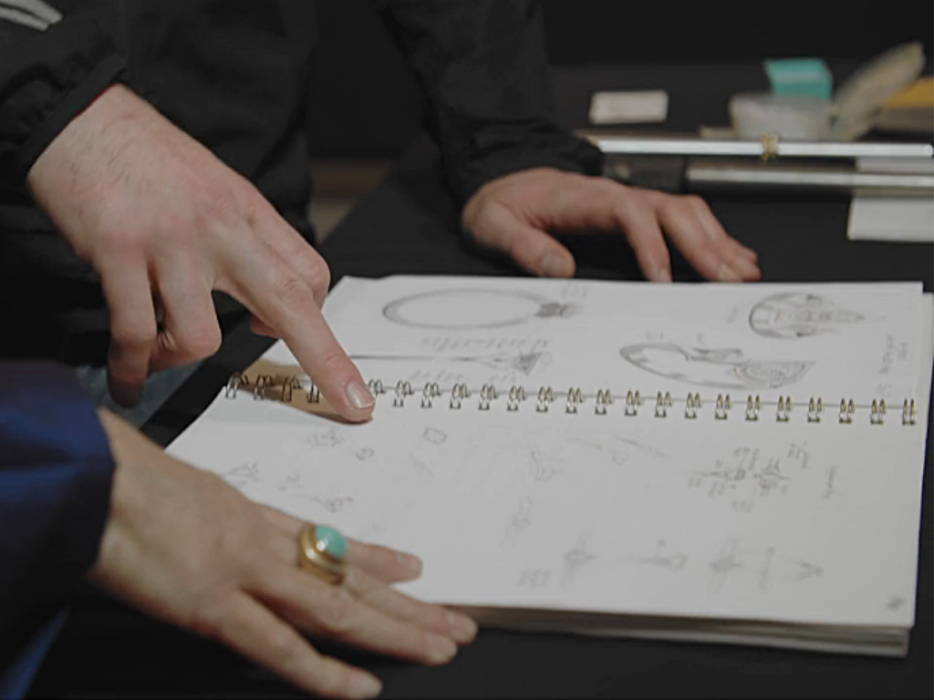 Discussing sketches for a stunning custom engagement ring.