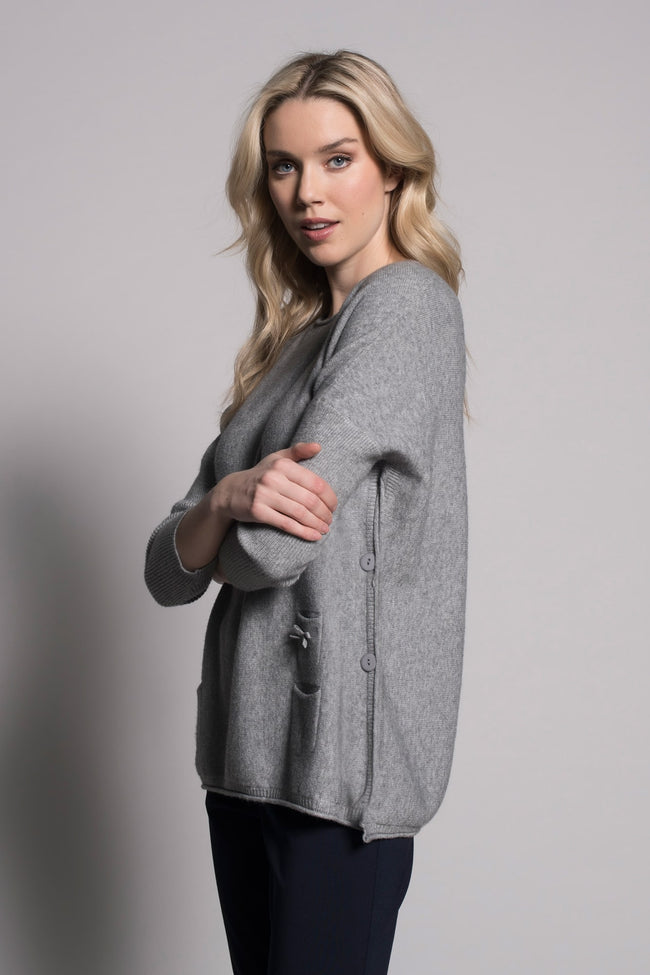 side view of grey flared sweater top with pockets by picadilly