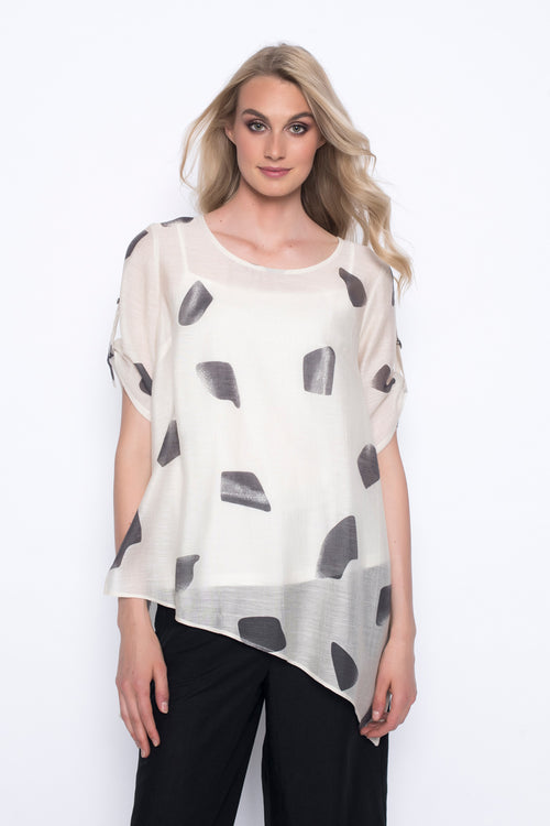 asymmetrical hem top in printed oversized polkadots
