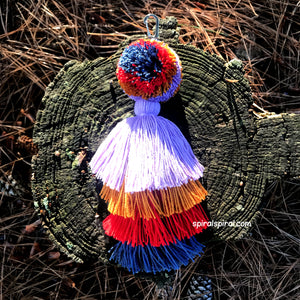 Multi colored wayuu pompom, handmade in Colombia, pompom with tassels.