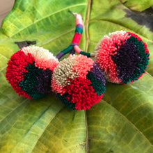 Keychain with 3 pompoms handmade in Colombia, multicolor,pink,beige,purple and red. You can use to decorate any spot in tour house, planters, walls or hanging in your bag or backpack.