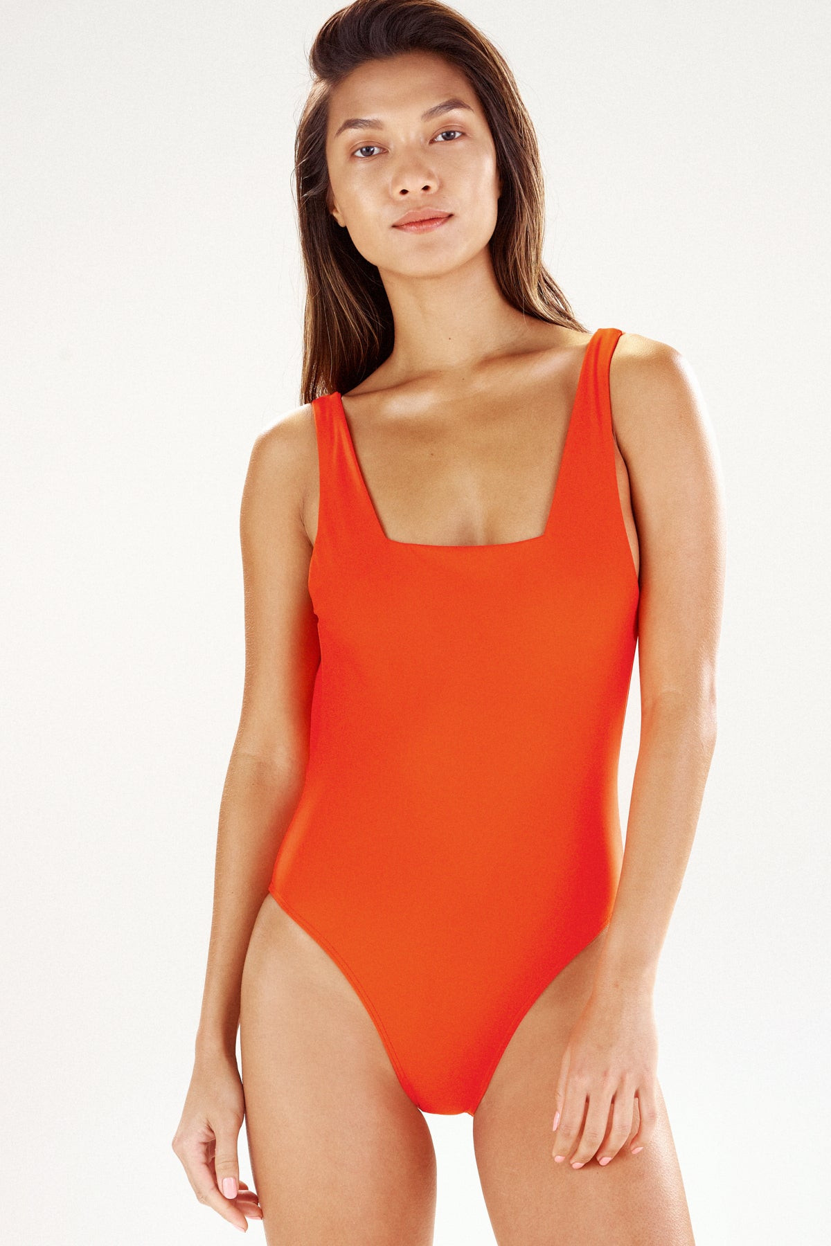 Girl in tangerine one-piece swimsuit, the Lisbon, by Ookioh