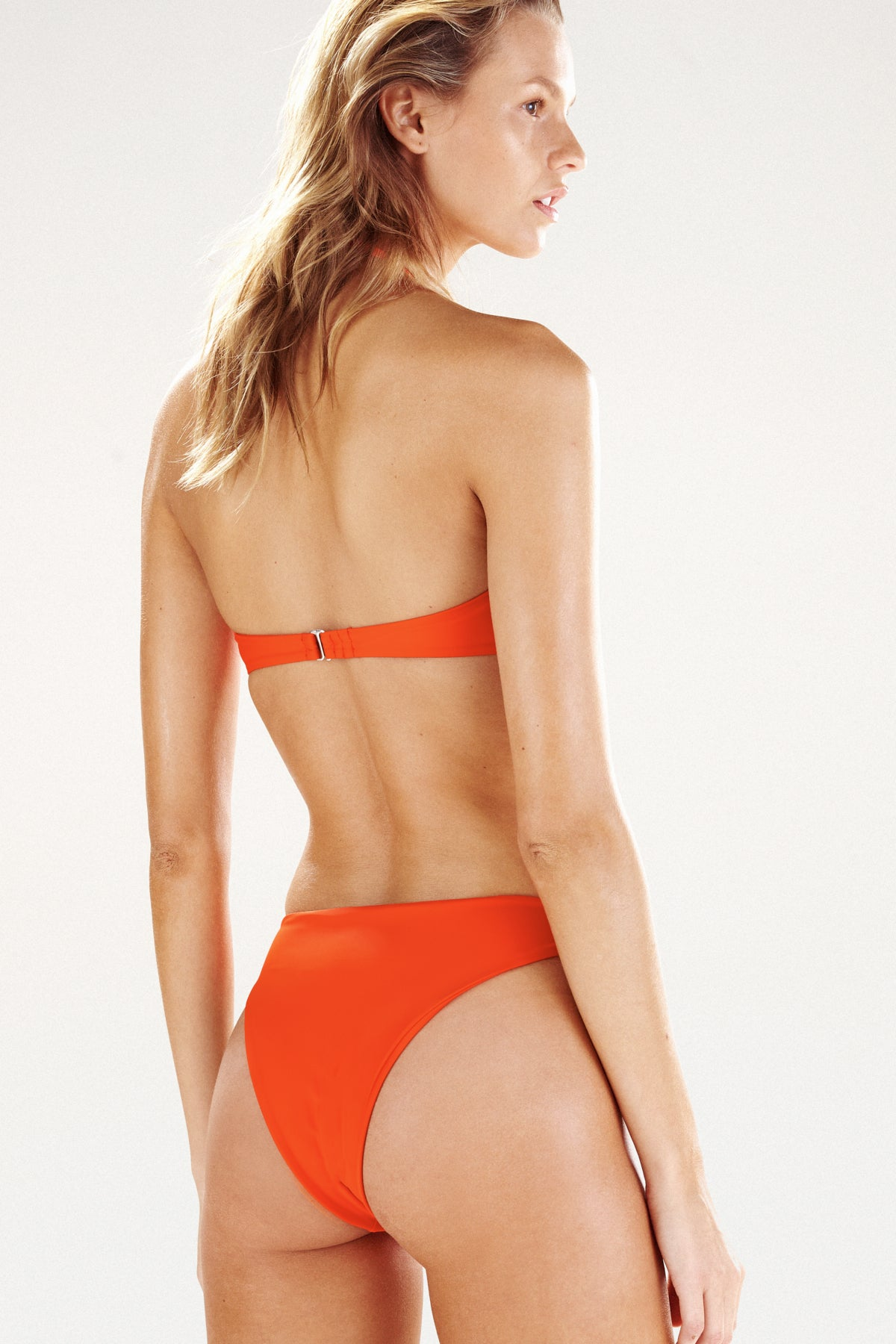 Back view of Monaco bikini bottom in tangerine
