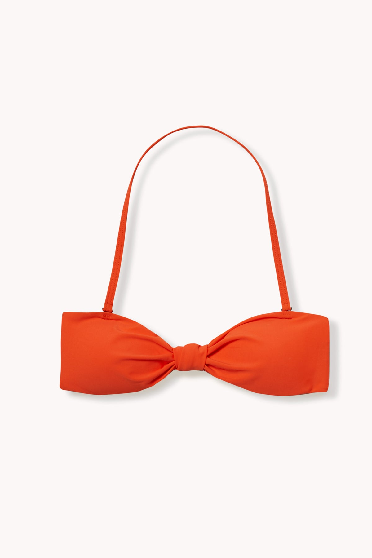 Detail shot of the bora bikini top, by Ookioh, in tangerine color
