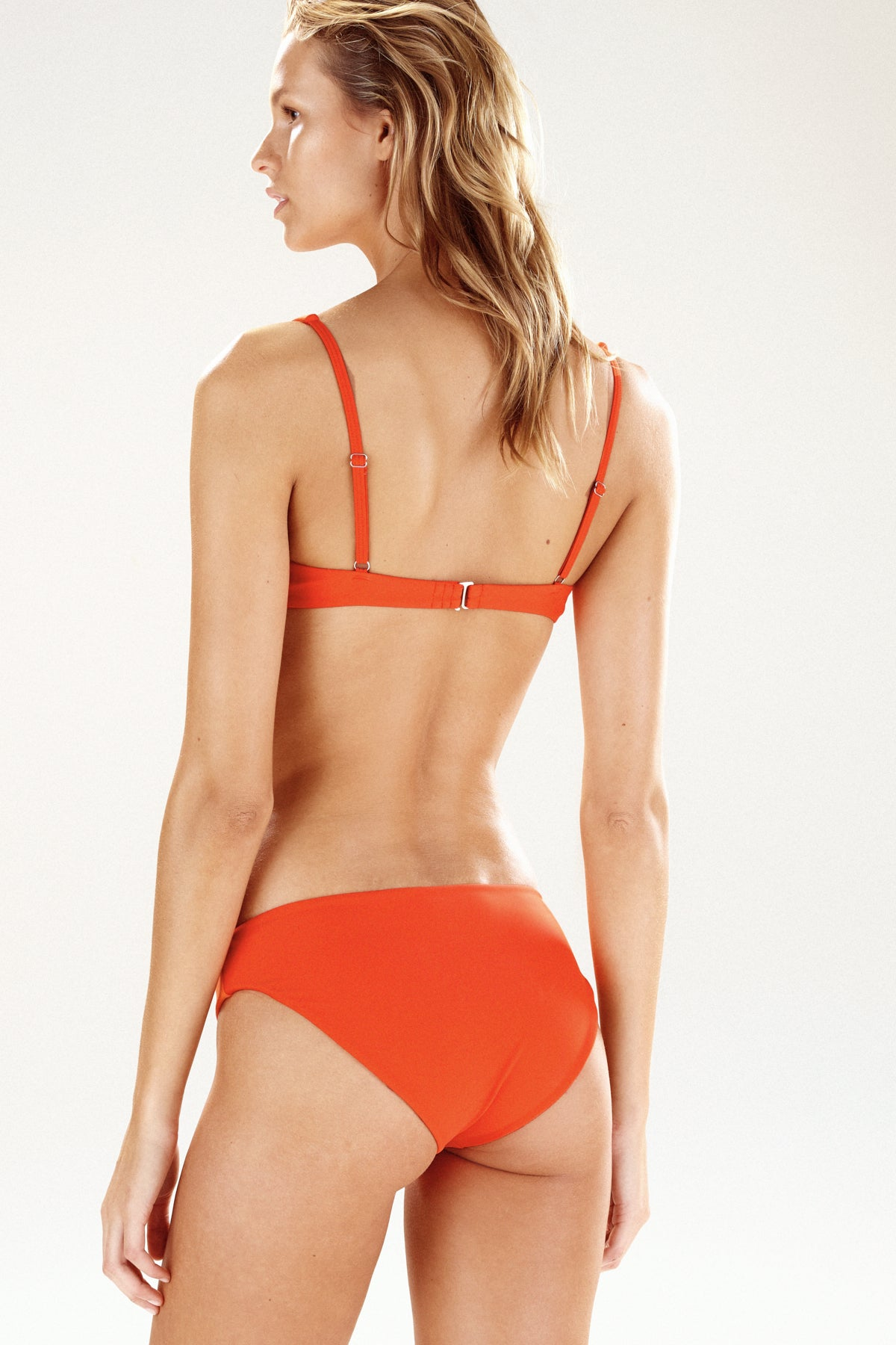 Back view of Como bikini top in tangerine