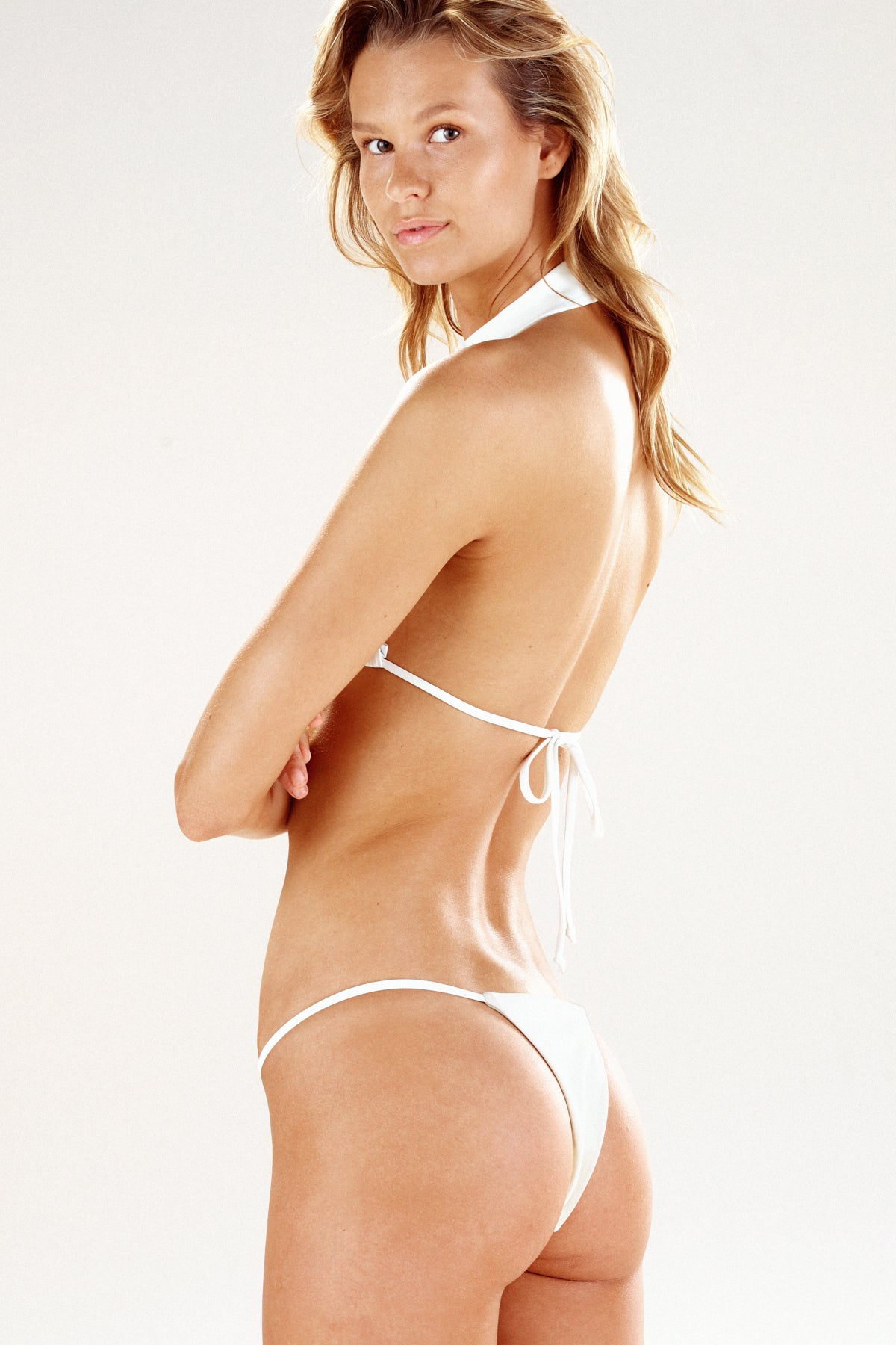 Side view of of cream Cayman bikini bottom by Ookioh