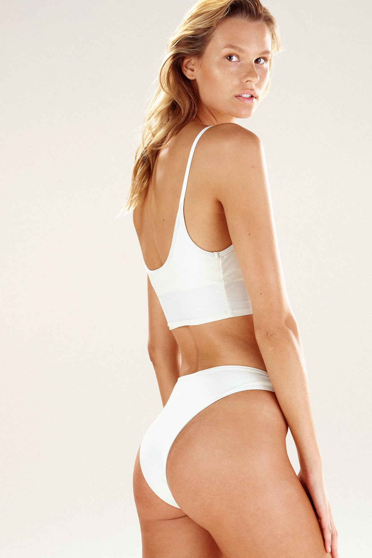Rear view of the Seattle bikini top in cream by Ookioh swimwear