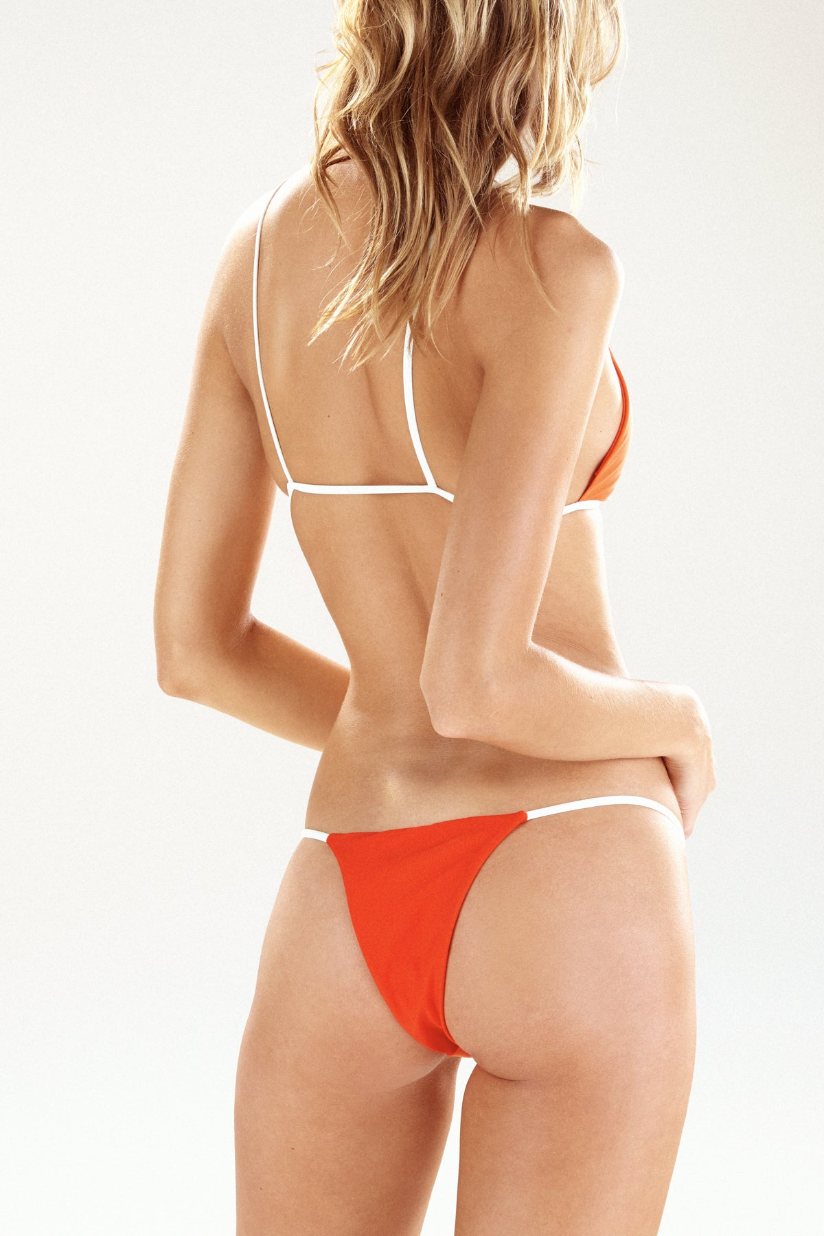 Back view of the Cayman bikini bottom in tangerine