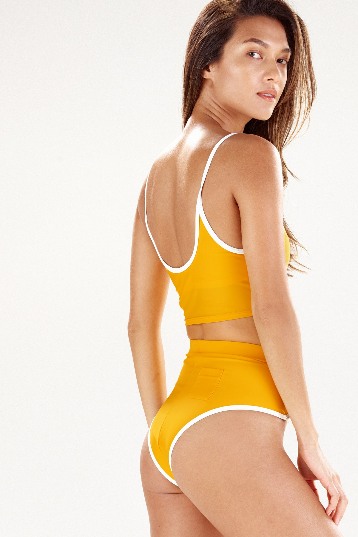 Rear view of Portland bikini bottom in marigold