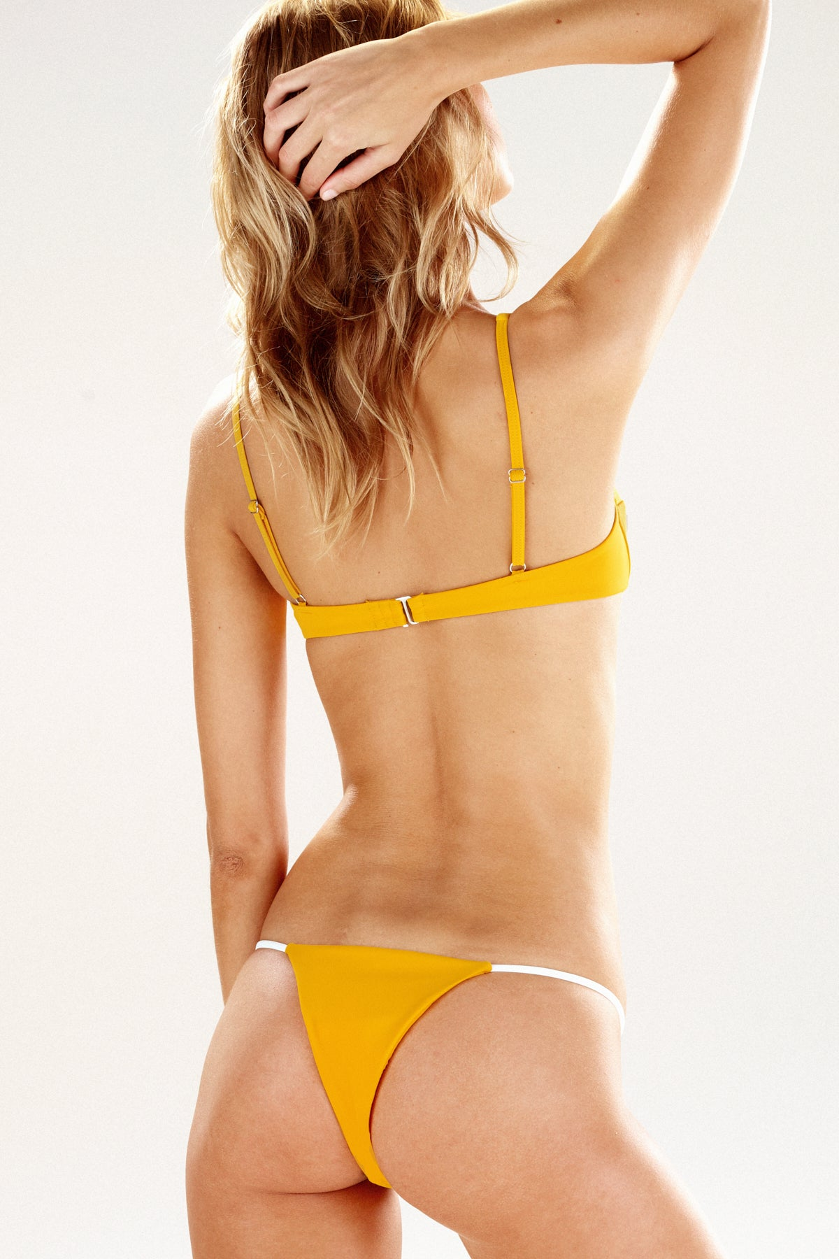 Rear view of the Como bikini bottom in marigold