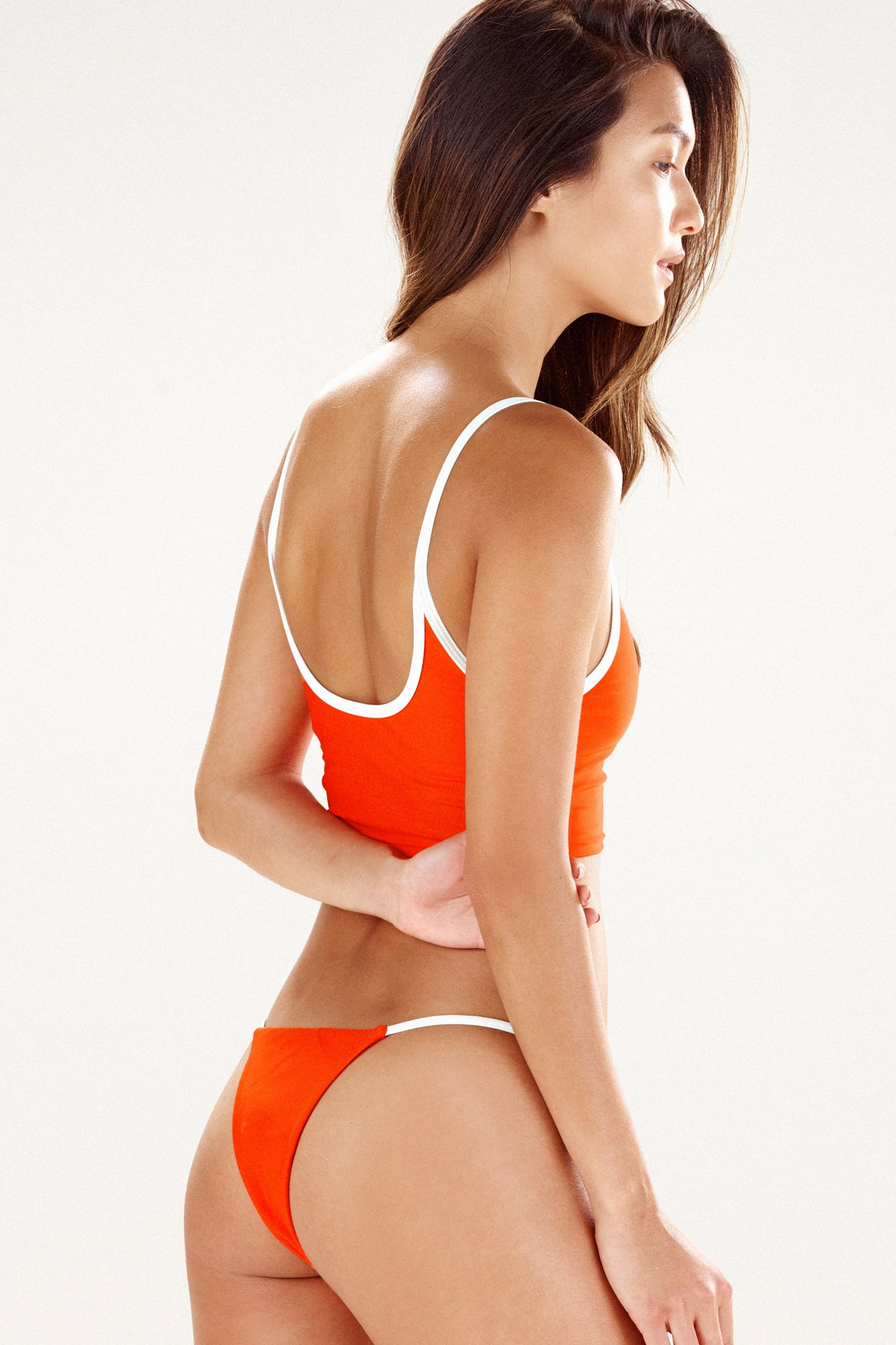 Side view of Seattle bikini top in tangerine