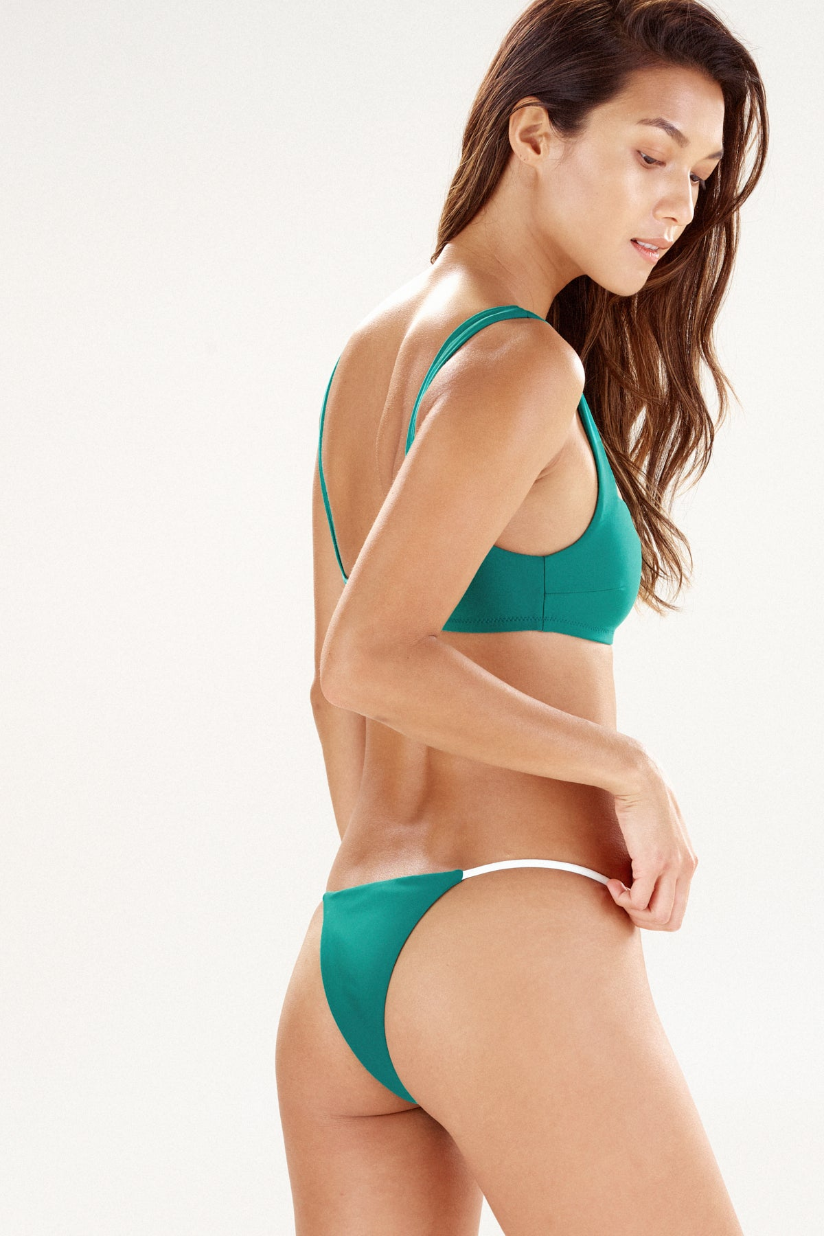 Back view of cayman bikini bottom in green
