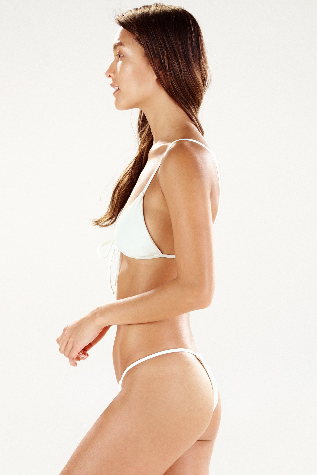 "Side view of cream bikini top ""Santos"" by Ookioh"