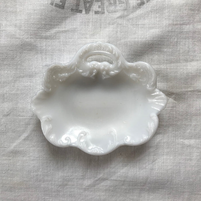 Ornate milk glass ring dish