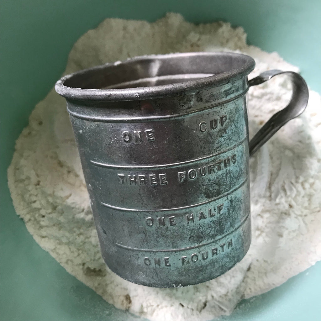 Vintage tin measuring cup