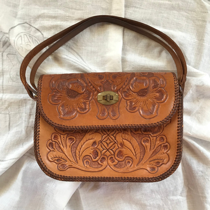 Vintage tooled clutch