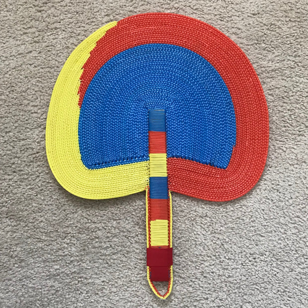 African woven hand fan from recycled plastics - Blue / Yellow / Red - Afrilege