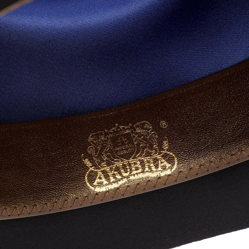 View of the inner leather band on the Akubra Bronco in Black showing gold-stamped Akubra logo.