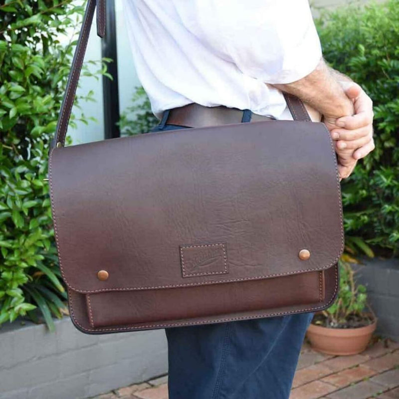 Person with Akubra Canning Satchel in Brown leather over their shoulder.