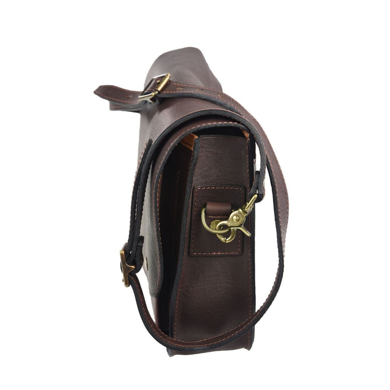 Akubra Canning Satchel in Brown leather, showing strap detail.