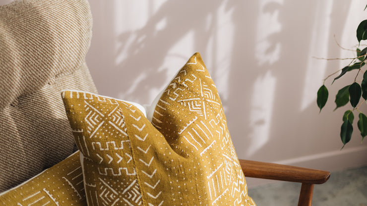 Ethical mudcloth cushions made by artisans in Mali, transformed into luxury cushions by former refugees building new lives in New Zealand