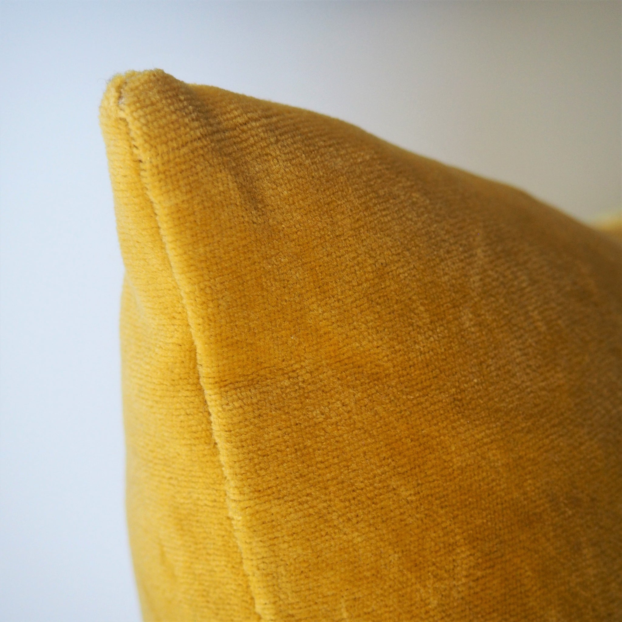 Ethical and eco friendly organic mustard velvet cushion made by former refugees building new lives in New Zealand