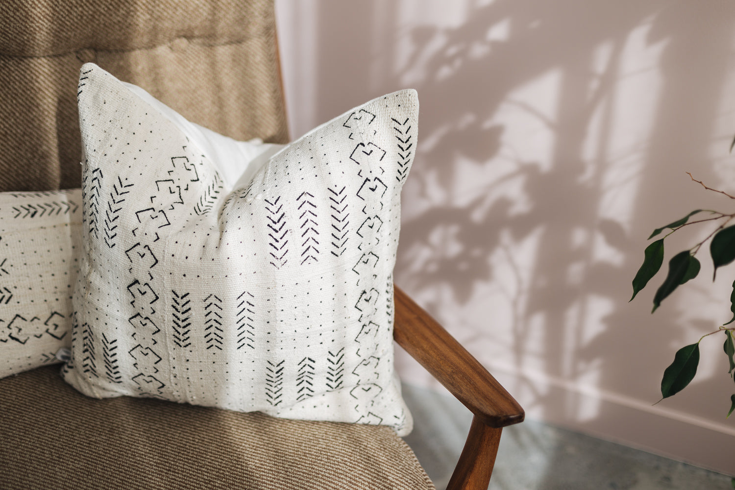 Ethical white mudcloth cushion made by former refugees using traditionally made artisan-crafted fabric. Contemporary global style with soul
