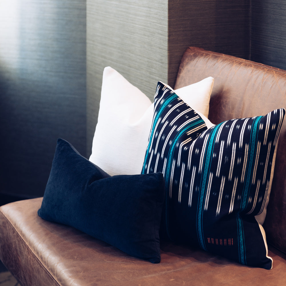 Ethical hand dyed, hand woven artisan crafted navy turquoise stripe baoule cushion made by former refugees building new lives in New Zealand