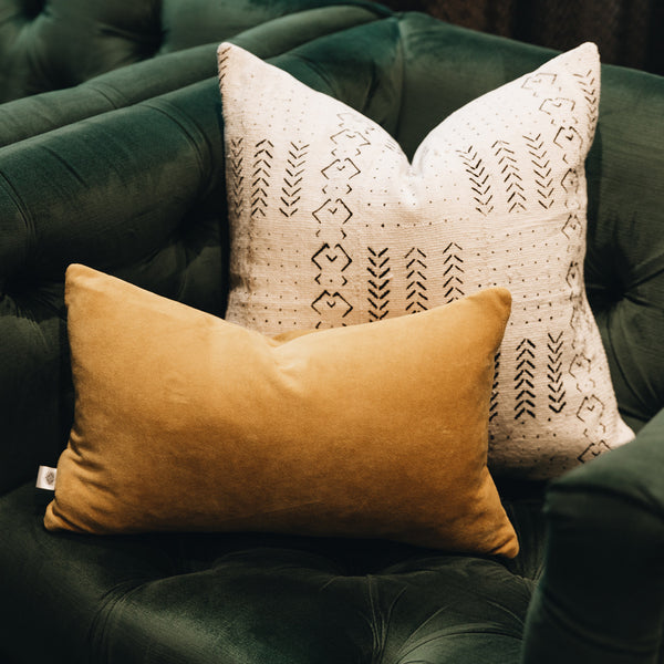 Ethical and eco-friendly organic mustard velvet cushion made by former refugees building new lives in New Zealand
