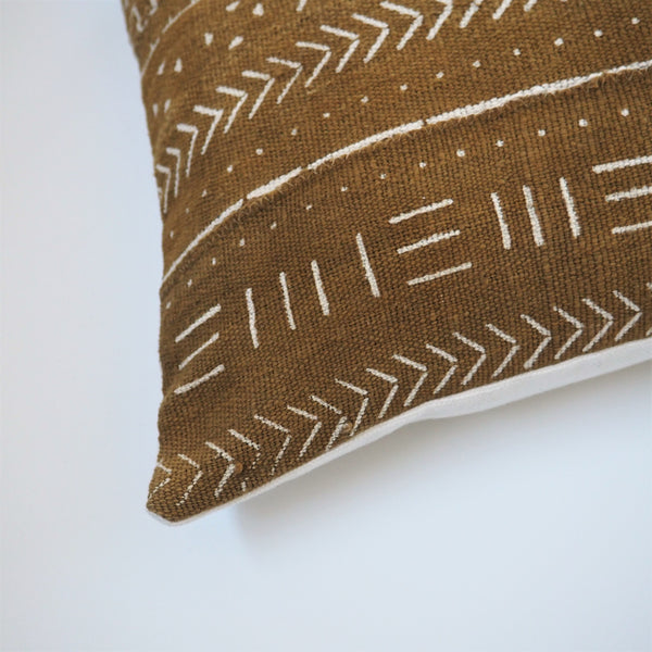 Ethical olive green mudcloth cushion made by former refugees using traditionally made artisan-crafted fabric. Contemporary global interior style with soul