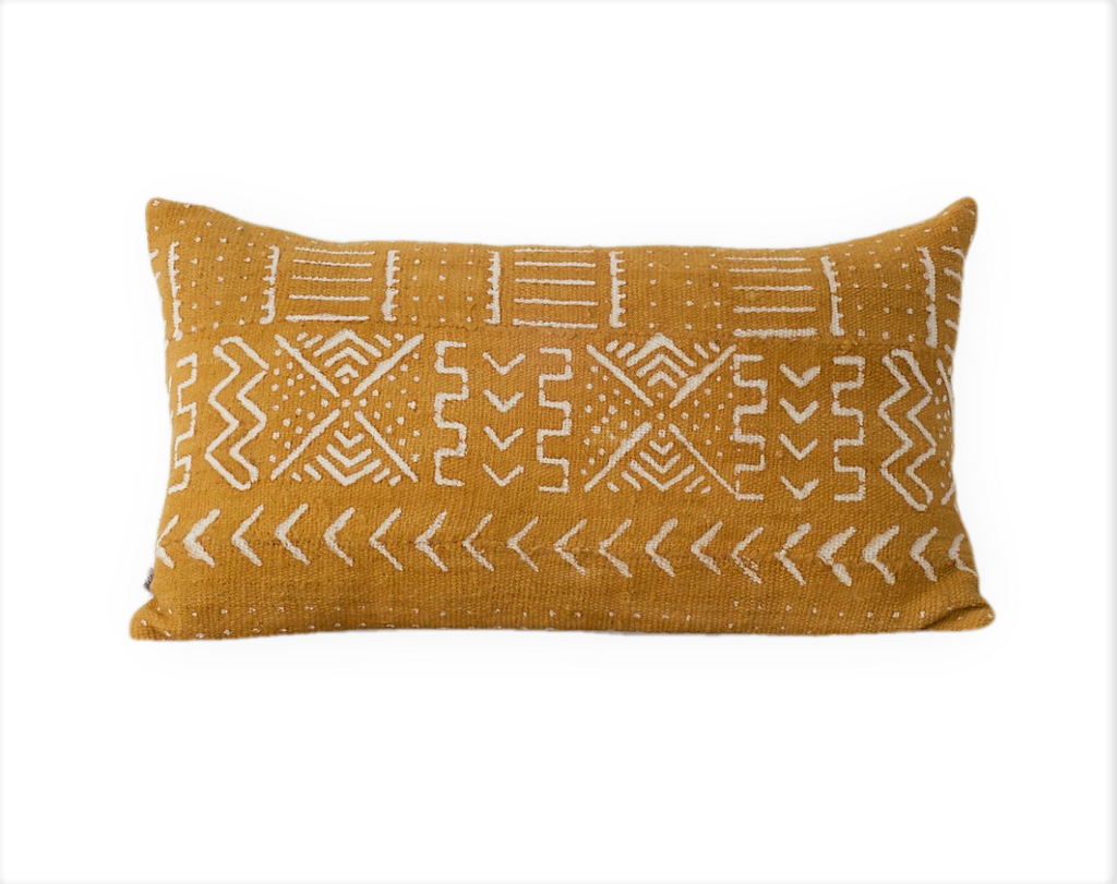 Ethical mustard yellow mudcloth cushion made by former refugees using traditionally made artisan-crafted fabric. Contemporary global interior style with soul