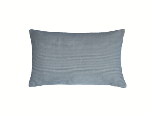 Zero waste cream ribbed cushion keeping high end textiles out of landfill and creating employment for former refugees