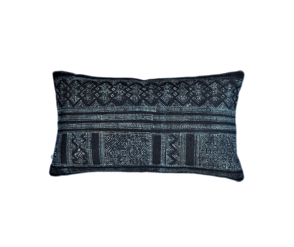 Ethical indigo blue hemp batik cushion made by former refugees using traditionally made artisan-crafted fabric. Contemporary global interior style with soul