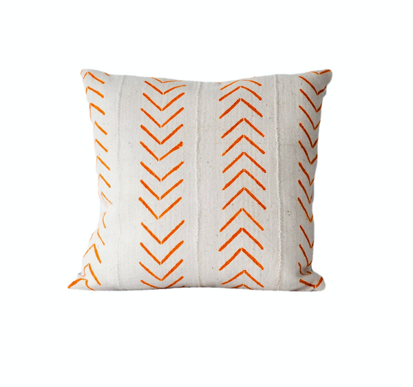 Ethical white mudcloth with orange arrows cushion made by former refugees using traditionally made artisan-crafted fabric. Contemporary global interior style with soul