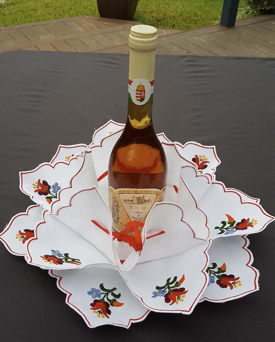 """Kalocsai"" style colour embroidered wine and bread holder 38cm dia"