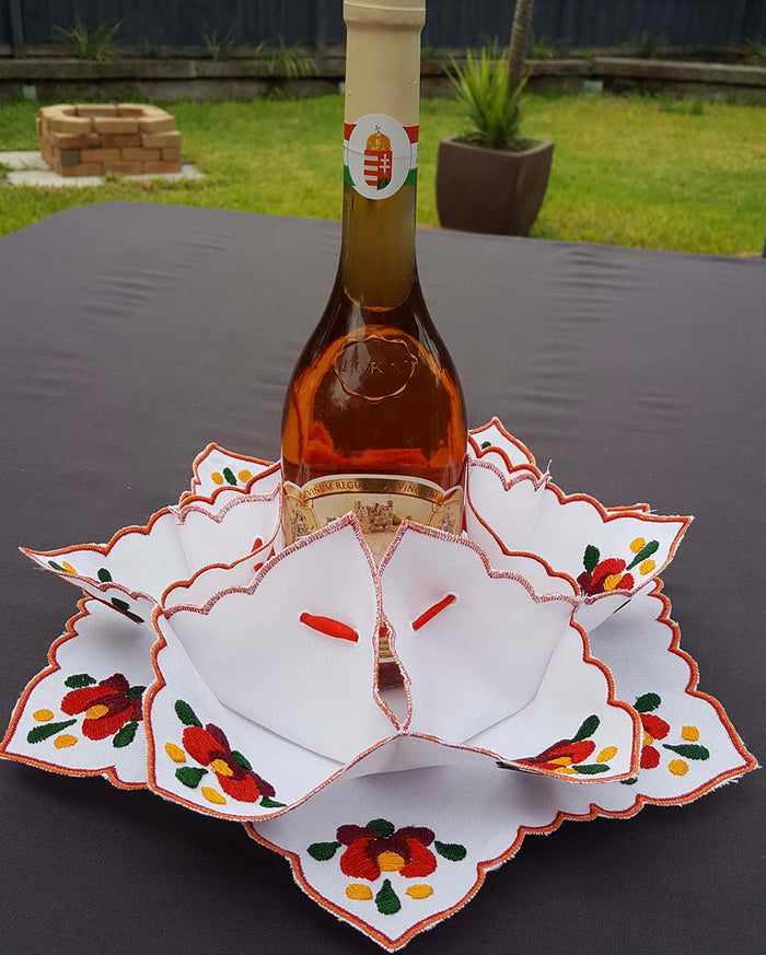 """Matyo"" style colour embroidered wine and bread holder 31cm dia"