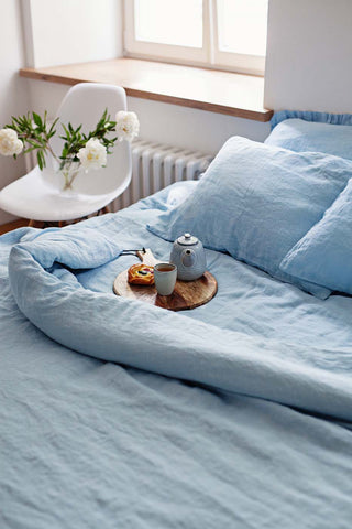 light blue linen bedding with the breafast