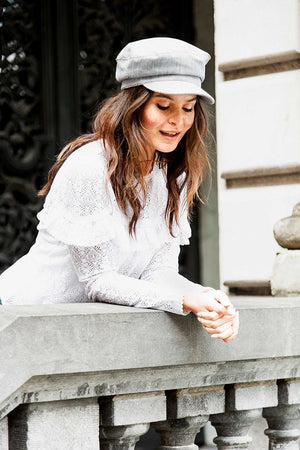 Streetstyle picture with striped sailor cap and white lace ruffle blouse