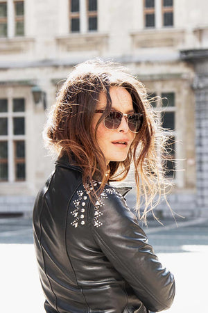 Street fashion picture of black leather jacket with studs
