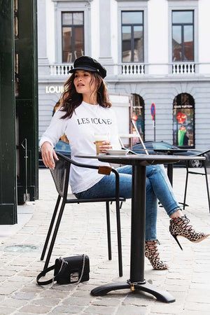 Streetstyle fashion picture of white ladies sweater with black logo print