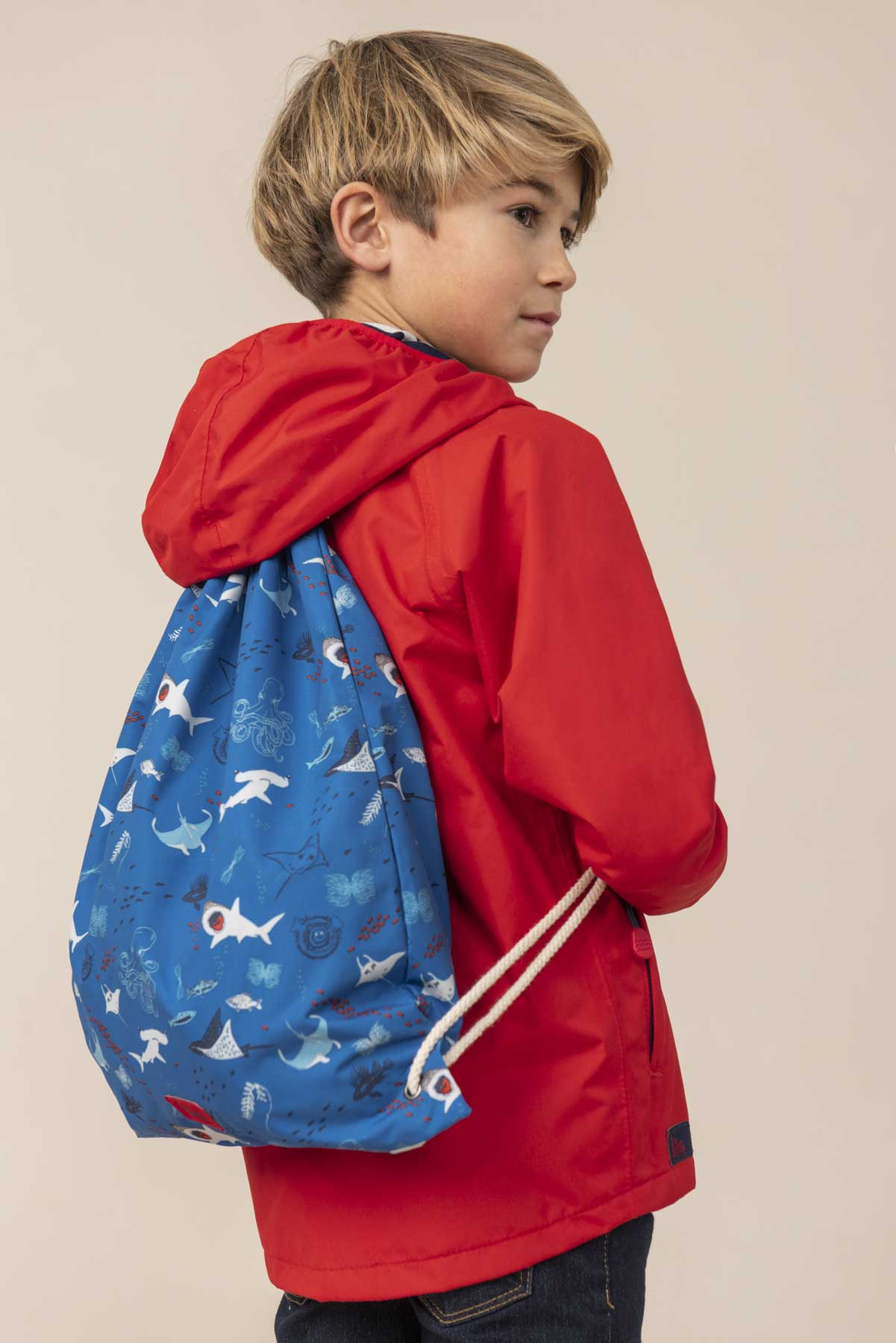 Boy's blue waterproof drawstring kit bag